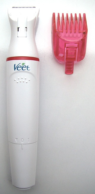 Bigger Head Of Veet Electric Trimmer And Its Comb Attachment